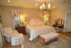 Traditional Master Bedroom with Brennan Trunk Coffee Table by Wildon Home ?, Hardwood floors, Carpet, Chandelier, Flush