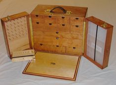 The fly tying case is made of 3/8 thick sapele and is approx 18 x 15 x 11 and has 13 cherry drawersfor feathers, furs, and tools. In addition there are 36 spool holders, containers for...