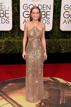 """Actress Brie Larson proved she's every bit Hollywood's golden girl in a stunning cut-out sparkly custom-made Calvin Klein gown at the 73rd Annual Golden Globe Awards held at the Beverly Hilton Hotel on Jan. 10, 2016. The 26-year-old is nominated for Best Actress in A Motion Picture - Drama for """"Room,"""" in which she plays a single mother who escapes years of activity."""