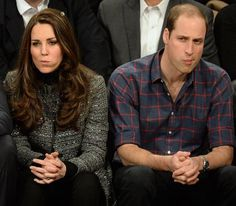 even royalty gets popcorn stuck in their teeth!!! awkward but REAL moment & that's why we love them (in NYC @basketball game having just shared popcorn on the front row .... photographers HAVE to get everything!