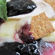 """Blueberry Brie - """"You can also make this with raspberry sauce or sun dried tomatoes, both of which taste excellent. This will cook in the microwave in about 3 minutes. Serve with warm French baguette slices! Cheese Recipes, Appetizer Recipes, Snack Recipes, Cooking Recipes, Snacks, Party Appetizers, Fall Recipes, Baked Brie Crescent Rolls, Crescent Roll Dough"""