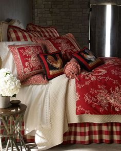 """Sherry Kline Home red and ivory """"French Country"""" comforter sets include toile comforter, coordinating pieced shams adorned with gimp and cording, and gathered buffalo-check dust skirt with 18"""" drop. Coordinating European shams and accent pillows are also available."""