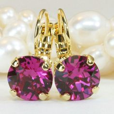 Fuchsia crystal earrings wirh gold finish is just so vivid!