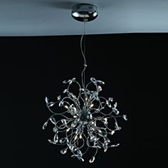 @Overstock.com - Extreme curves and twists of the arms on this hanging pendant form an effect unlike any other. This pendant is polished off in a gorgeous chrome silver finish, for a sleek contemporary design.http://www.overstock.com/Home-Garden/Joshua-Marshal-Home-Collection-Modern-18-light-Chrome-Crystal-Encompassed-Adjustable-Hanging-Pendant/6985654/product.html?CID=214117 $284.39
