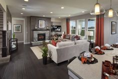 Like this family room, clean lines, neutral earth tones and little pops of color.