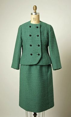 Suit.  House of Balenciaga (French, founded 1937).  Designer: Cristobal Balenciaga (Spanish, 1895–1972). Date: fall/winter 1963–64. Culture: French. Medium: wool, silk, beads. Dimensions: Length (a): 20 in. (50.8 cm). Length at CF (b): 24 3/4 in. (62.9 cm).
