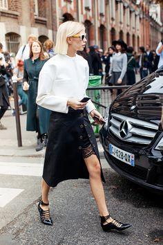 Street style : autumn winter.  White sweater & black leather skirt