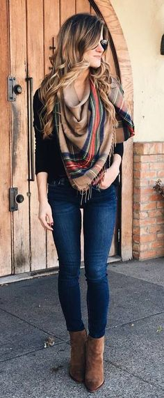 what to wear with a plaid scarf : black top + skinny jeans + boots