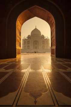 I love this photo do the Taj Mahal because it's not the typical photo you see of the Taj Mahal (Taj Mahal and it's reflection). I also love how the arch around the Taj Mahal immediately draws your eye to the building. Places Around The World, Oh The Places You'll Go, Travel Around The World, Places To Travel, Places To Visit, Taj Mahal India, Wonderful Places, Beautiful Places, Beautiful Pictures