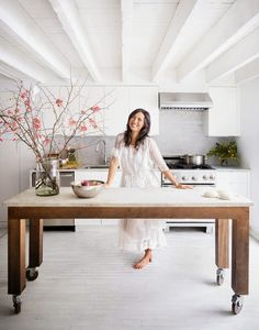 big wooden table in kitchen. no need for a center island. home decor and interior decorating ideas