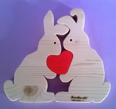 Puzzle of animals gift wood Puzzle rabbits educational toys Puzzle Toy wooden rabbits Wooden animal heart valentines day Wooden animal puzzle wooden childrens wood rabbit wooden puzzle bunny educational toys montessori toys love gift kids rabbits lovers valentines day. Decorations in solid pinewood entirely made by hand with scrollsaw.  Our wooden puzzle are the perfect gifts to give to your loved ones!  The dimensions of each heart are equal to 6,7 height and 7,1 width, for a thickness of…