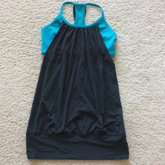 Lululemon athletic tank Lululemon athletic tank. Super cute black and teal green. Built in bra for added support. Size 4. Great condition.  #245 lululemon athletica Tops Tank Tops