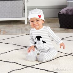 What's gray, black and white, and cute all over? It's this penguin pajama gift set, with footie PJs, a matching cap and a penguin whose heart is in just the right place!