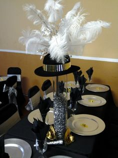 Top hat centerpieces - could be replicated inexpensively using party supply store items.