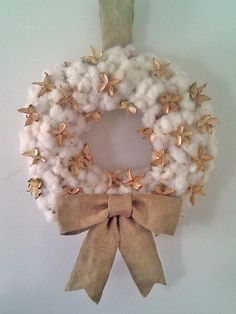 I need to make a visit to Uncle Coy's & get some cotton! Raw Cotton Boll Wreath With Burlap Bow.