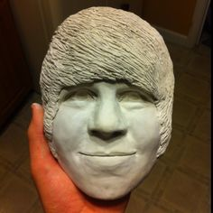 My son's clay sculpture of himself.