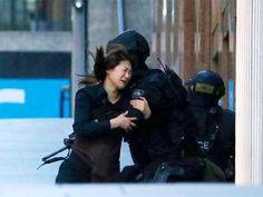 Slideshow : Three hostages escape - Hostages held inside Sydney cafe, Islamic flag held up - The Economic Times