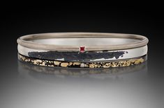 Such beautiful bangle with such interest metals!