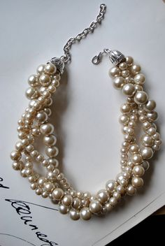4 strands of glass pearls twisted in a perfectly wild display of sweet girly pearls and chaos. Sizes of pearls measure from 8mm, 12mm and 14mm.  Adjustable lobster clasp closer. Necklace measures 16 inches with 2 inch extender.