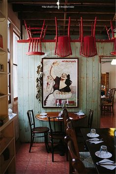 Chairs on ceiling to make a quirky, affordable, wow factor in long space.
