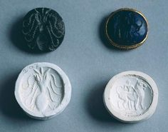 Seals with mold depicting a bee and a man with a lion from Knossos (Greece). Minoan Civilization, 17th–15th Century BC.