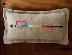 heart and arrow pincushion by Laura, via The Purl Bee