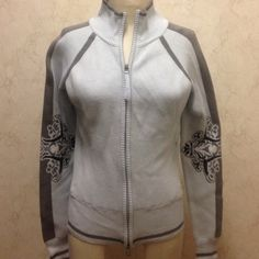 Athleta light blue and grey zipped front jacket Athleta blue and grey zipped front sweater with design on back elbows on both arms. Two side zip pockets. Athleta Other