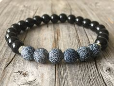 Men gemstone beaded stretch stacking surf bracelet.  Black onyx gemstone beads 8 mm Matte spider web gemstone beads 8 mm Little tibetan silver beads  Easy to wear and look als great with other bracelets together.  Size bracelet 7,8 inch (20 cm). if you need an other size please, mail us.  If you sending the item as an gift, please let us know. We can enclose a gift note for you as well.  Delivery time US 3 - 6 days Australia 5 - 10 days Canada 5 - 6 days If you want to know how long the…
