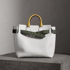 A belted tote influenced by our iconic trench, panelled inside and out in supple two-tone leathers.