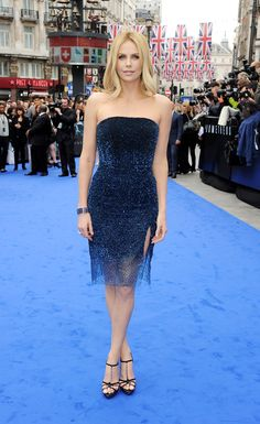 Charlize Theron wearing a beautiful Dior sequin dress and chain embellished Dior t-strap platform sandals.