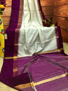 Look ravishing like never before as you deck up this Silk Mark Certified pure ghicha raw silk saree from the online store of IndyVogue. This white saree will se Silk Saree Kanchipuram, Raw Silk Saree, Kanjivaram Sarees, Silk Cotton Sarees, Organza Saree, Pure Silk Sarees, Gadwal Sarees Silk, Silk Sarees Online Shopping, Saree Shopping