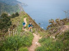 Riding through spring flowers high above the Atlantic Ocean. Basque in it!