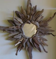 Sunburst mirror from chunky pieces of driftwood, it has a different look to it.