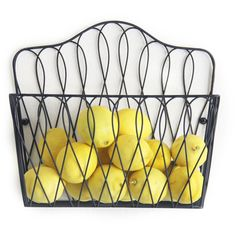This wall-mounted Wire Storage Basket makes the perfect companion because it's handy, good-looking and fits anywhere. The piece makes a great space saver by hanging the basket in a kitchen pantry, office or bath.