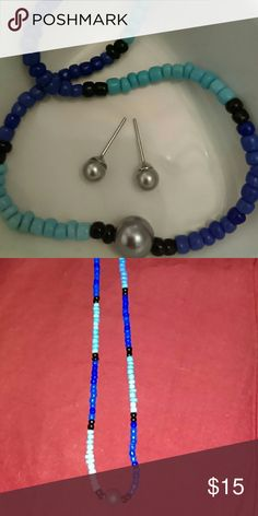 """Homemade Choker Set Beautiful multi colored glass beads in turquoise, dark blue and black with large simulated grey pearl in center, comes with matching grey earrings. Measures 16"""". Strung on a silver plated chain. Jewelry Necklaces"""