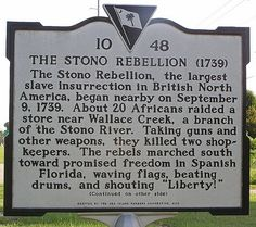 """Historic Marker: The Stono Rebellion, the largest Slave Insurrection in British North America, began nearby on September 9, 1739. About 20 Africans raided a store near Wallace Creek, a branch of the Stono River. Taking guns and other weapons, they killed two shop-keepers. The rebels marched South toward promised freedom in Spanish Florica, waving flags, beating drums, and shouting """"Liberty!"""" (cont'd)"""