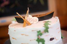one tier wedding cake that looks like birch bark, custom canoe and oars cake topper, rustic lakeside wedding, Danielle Pasternak, Wedding Coordinator, Lalee Photography