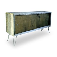 Modern Arks - Better with Age:  Tennessee-based Modern Arks knows the beauty of naturally aged woods. That's why their credenzas and tables tend to feature reclaimed woods. As their works show, nothing contrasts with metal hairpin legs quite like nicely weathered barnwood. Locally harvested hardwoods are occasionally used for varying wood texture and an eclectic touch.