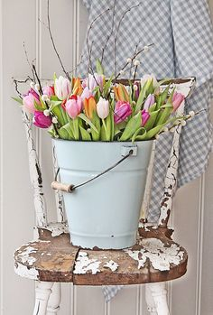 Bucket of tulips. Rustic chair. Spring vignette. #country #farmhouse #DIY