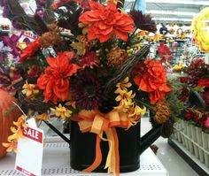 Fall Watering Can Arrangement designed by A.C. Moore Severna Park, MD