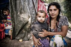 #Gypsies - #Gypsy Mother and child in a settlement in Strasbourg Where about 30 Roma live without water and electricity. They aussi risk Being Evicted any time by the government