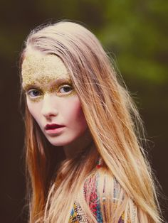 Today she wears her forehead adorned with gold leaf. She is all the more seductive for being luminous rather than dark.