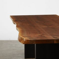 A walnut book matched tabletop with a black wood infill base. We salvaged this tree in Seattle.