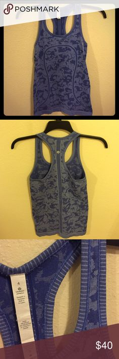 Blue/deep violet lululemon swiftly tech tank Granite tank only worn a few times-perfect condition. I think it's a deep blue color-last 2 pics are best real life color lululemon athletica Tops