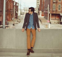 "A.P.C. Two-button Harris Tweed blazer, denim shirt, Baldwin Denim duck canvas ""Reed"" pant, chocolate suede ""8878"" Red Wing boots, black-framed glasses. A good look."