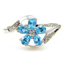 14K Blue Topaz Floral Ring. Get the lowest price on 14K Blue Topaz Floral Ring and other fabulous designer clothing and accessories! Shop Tradesy now