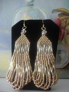 Fringe Chandelier Seed Bead Earrings by WorkofHeart on Etsy, $28.00  These make me think of the large, dangly, and opulent earrings of the 1920s