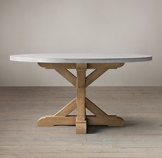 Salvaged Wood & Weathered Concrete X-Base Round Dining Table from Restoration Hardware
