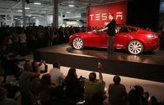 Tesla chief Elon Musk reaches for stars