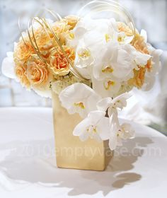 Nothing can compare to gorgeous garden roses - and they look stunning with the beautiful orchids!  (Empty Vase Florist of Los Angeles)